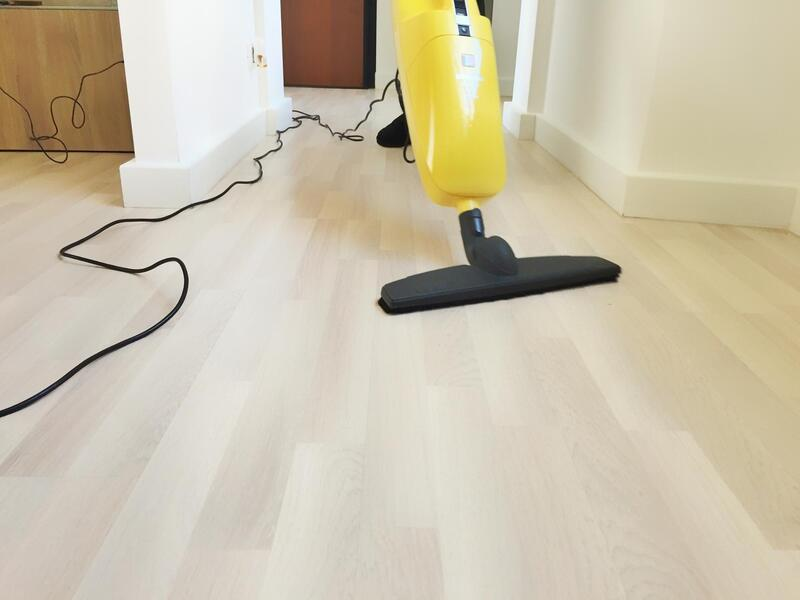 man mopping the floor