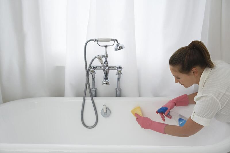 girl cleaning the bath tub